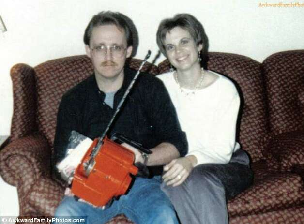 He couldn't decide whether he loved her or his chainsaw more. Photo: © AwkwardFamilyPhotos.com