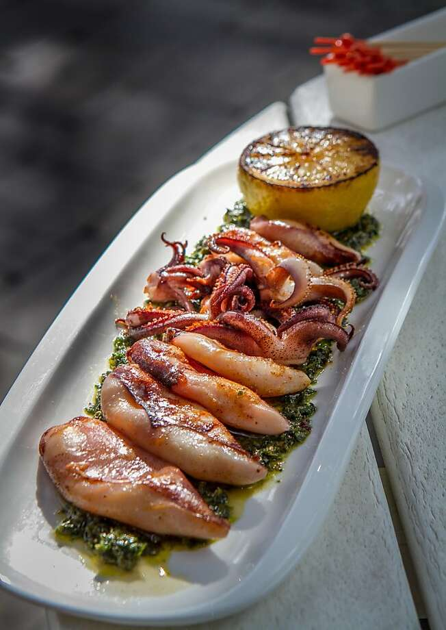 The Monterey calamari on salsa verde has a grilled half lemon that enlivens the mix. Photo: John Storey, Special To The Chronicle