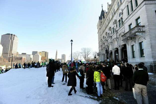 "A ""March for Change"" rally is held on the steps of the Capital in Hartford, Conn., Thursday, Feb. 14, 2013, to promote common sense and practical changes to the state's gun laws. Photo: Carol Kaliff / The News-Times"