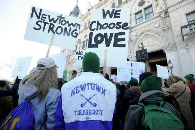 "Zoe Egglestan, 18, and her sister, Zoe, 15, of Newtown, participate in Thursday's ""March for Change"" rally held on the steps of the Capital in Hartford, Conn., Thursday, Feb. 14, 2013, to promote common sense and practical changes to the state's gun laws. Photo: Carol Kaliff / The News-Times"