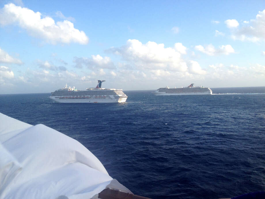 Photo from Triumph passenger Ashley Riggs from the disabled Carnival ship. Other sister ships can be seen bringing in supplies. Photo: Ashley Riggs, .