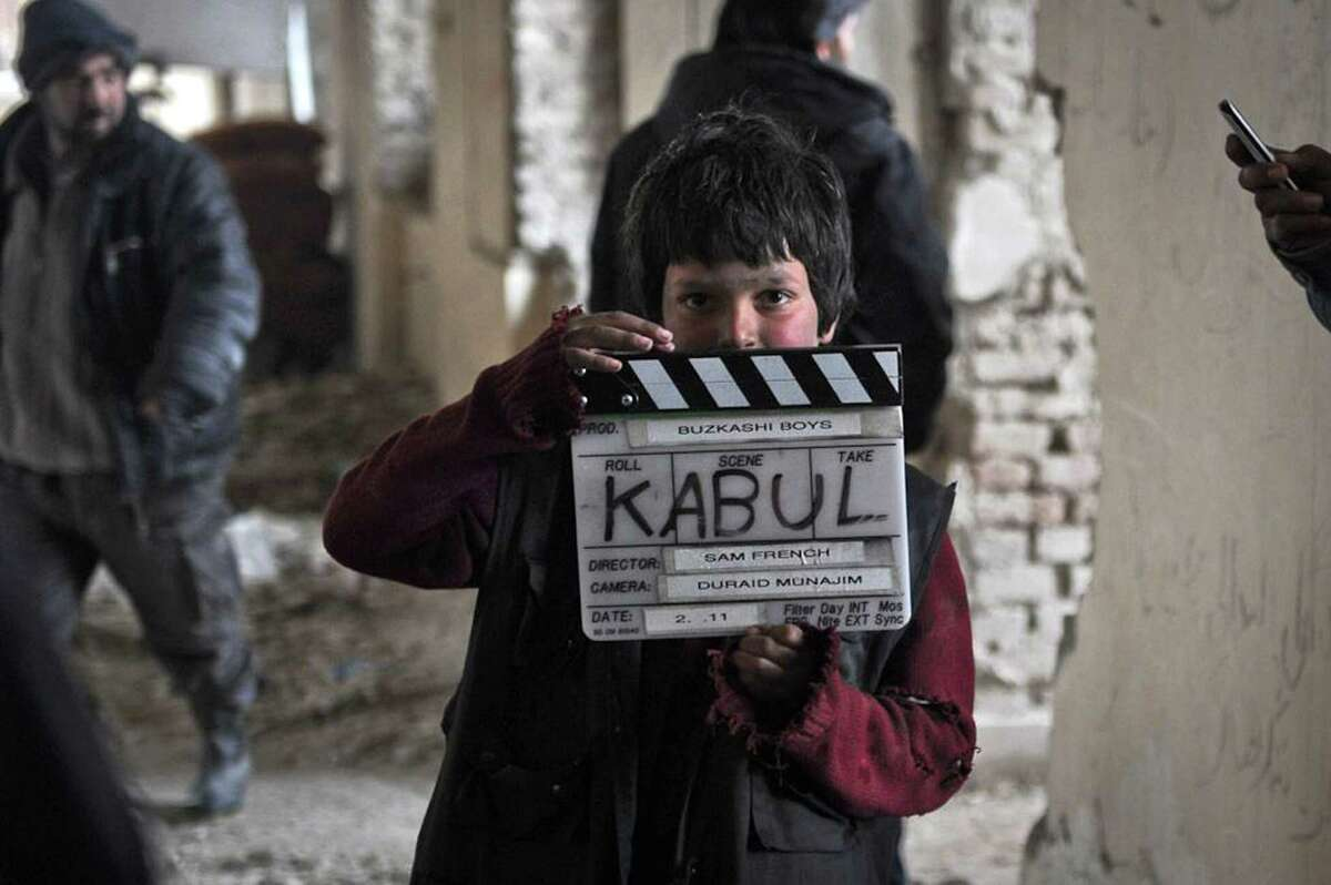 """An undated production still photograph from the Oscar-nominated film, """"Buzkashi Boys,"""" which was filmed in Kabul, Afghanistan, shows actor Jawanmard Paiz on the set of the film. Jawanmard Paiz was plucked from the dingy streets of the Afghan capital to be one of the main stars of ?""""Buzkashi Boys,?"""" a coming-of-age movie filmed entirely in a war zone and nominated in the Best Live Action Short Film category. (AP Photo/David Gill, Afghan Film Project)"""