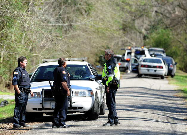 Beaumont Police searched a wooded area on Bigner Road Thursday after a high speed chase that began on the 7000 block of Scott's Drive. Three of four men were arrested from the chase and charged with evading detention. Police are also investigating as a possible burglary from the incident. Photo taken Thursday, February 14, 2013 Guiseppe Barranco/The Enterprise Photo: Guiseppe Barranco, STAFF PHOTOGRAPHER / The Beaumont Enterprise
