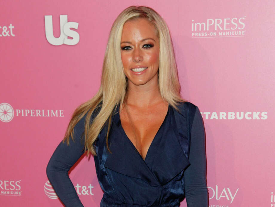 "Kendra Wilkinson – The sporty 'Girl Next Door' Kendra Wilkinson was a stripper before she was a Playmate. She told the Today show, ""I was a good person doing it. I wasn't a druggie stripper."" Photo: Imeh Akpanudosen, Getty Images / 2012 Getty Images"