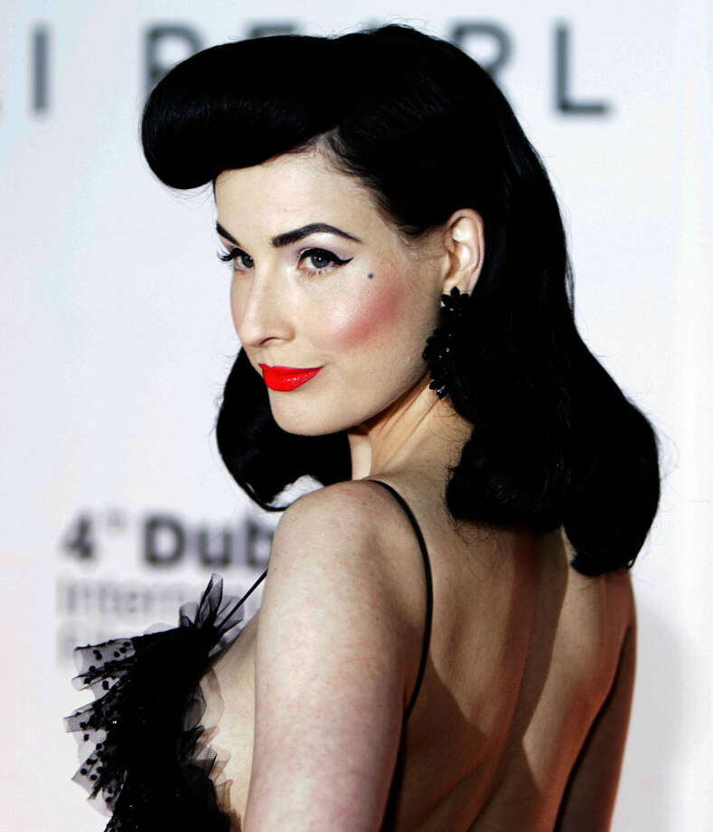 Dita Von Teese– A burlesque diva never without red lipstick, Dita Von Teese got her start working in strip clubs under her real name, Heather Sweet. Photo: KARIM SAHIB, AFP/Getty Images / AFP