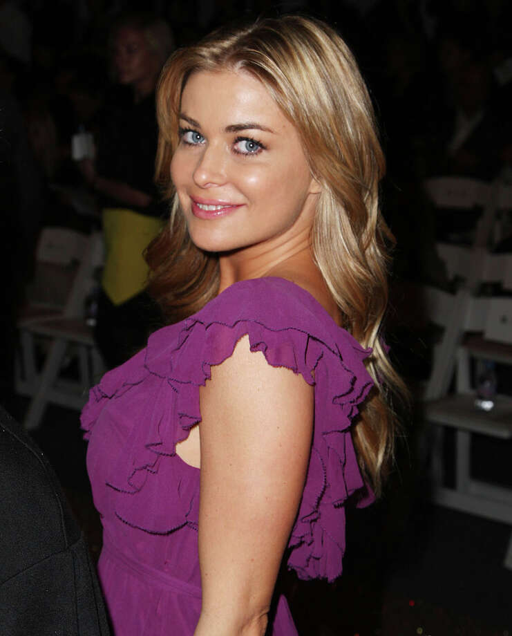 Carmen Electra – The former stripper later put out a set of poledancing fitness DVDs called Carmen Electra's Aerobic Striptease. Photo: Andrew H. Walker, Getty Images For IMG / 2008 Getty Images