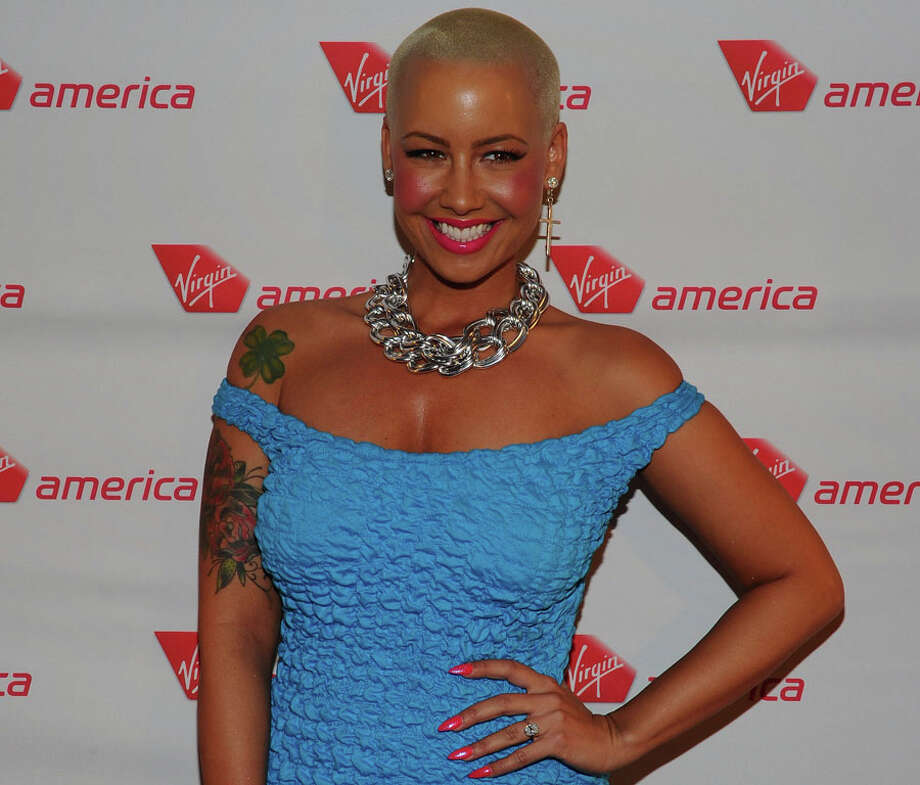 Amber Rose– Model Amber Rose said she began stripping at age 15.   Photo: Michael Buckner, Getty Images / 2012 Getty Images