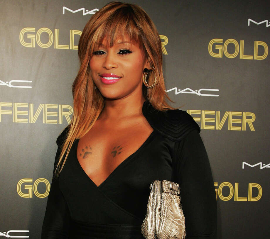 "Eve– Ruff Ryders rapper Eve sings about her stripper past, ""from dancing on tabletops to making labels pop"" in her song 'Heaven Only Knows.' Photo: Gaye Gerard, Getty Images / 2008 Getty Images"