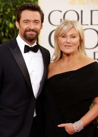 BEVERLY HILLS, CA - JANUARY 13:  Actor Hugh Jackman and wife Deborra-Lee Furness arrive at the 70th Annual Golden Globe Awards held at The Beverly Hilton Hotel on January 13, 2013 in Beverly Hills, California.  (Photo by Jeff Vespa/WireImage) Photo: Jeff Vespa, WireImage