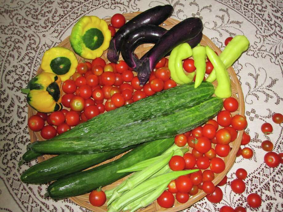 Spring vegetables include okra, peppers, tomatoes, eggplant, green beans,squash, cucumbers, amaranth, corn, sweet potatoes, sweet potato leaves, Malabar spinach, bitter melon, cantaloupe, watermelon and winter melon.