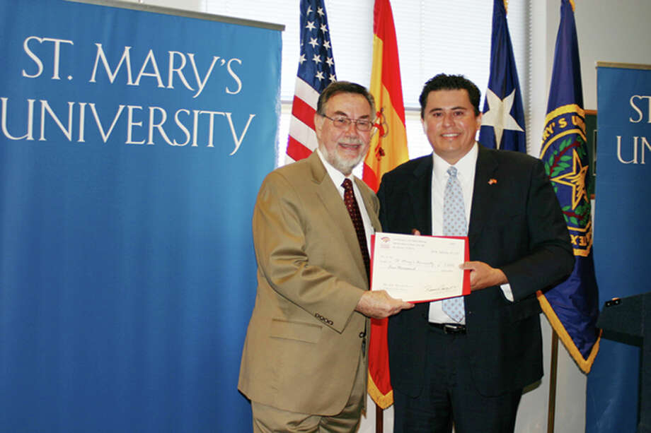 Ronaldo Pablos, right, at St. Mary's University.