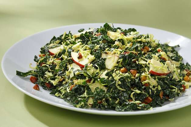 Kale & Brussels Sprout Salad With Toasted Almonds, Apples & Lemon-Tahini Vinaigrette; styling by Amanda Gold Photo: Craig Lee, Special To The Chronicle