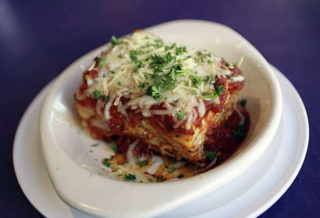 The Lasagna at Cerroni's Purple Garlic is filled with Italian sausage, pepperoni, marinara sauce and two cheeses. Photo: Photos By Helen L. Montoya / San Antonio Express-News