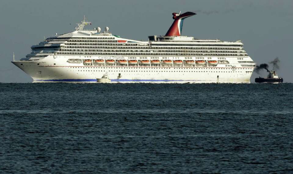 The cruise ship Carnival Triumph is towed towards Mobile Bay near Dauphin Island, Ala., Thursday, Fe