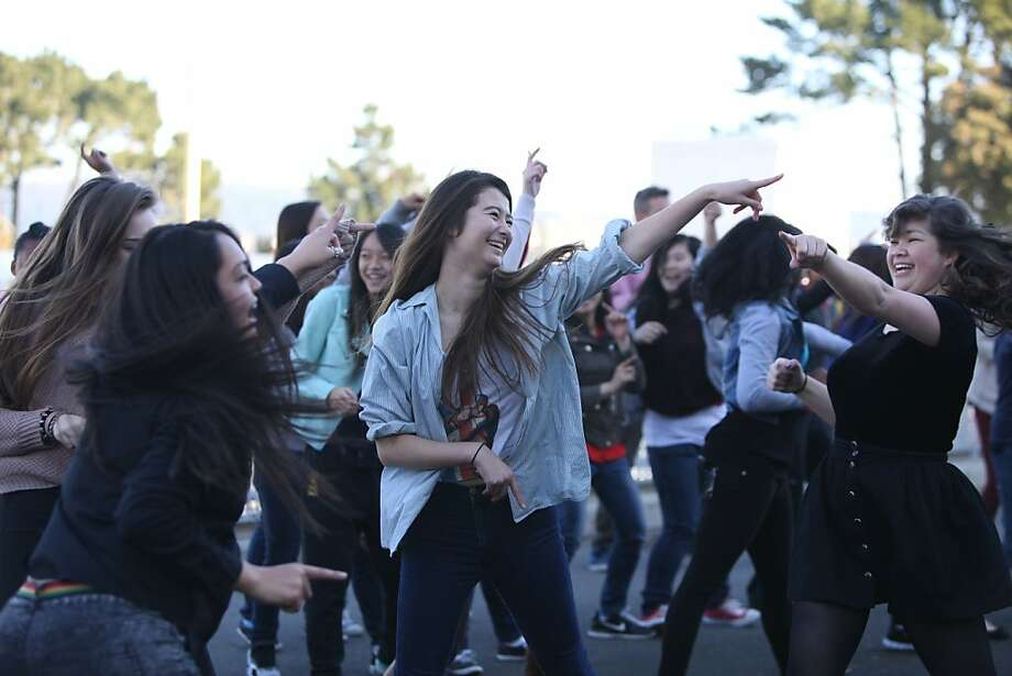 Amy Baker dances with classmates on the esplanade at George Washington High School in S.F. The event is part of the daylong, global One Billion Rising campaign to raise awareness about violence against women. Photo: Pete Kiehart, The Chronicle
