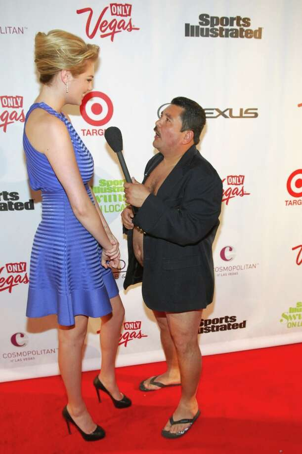 Sports Illustrated swimsuit model Kate Upton (L) with TV personality Guillermo at SI Swimsuit on Location at the Marquee Nightclub at The Cosmopolitan of Las Vegas on February 13, 2013 in Las Vegas, Nevada. Photo: Bryan Steffy, Getty Images / 2013 Getty Images