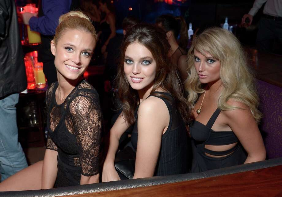 (L-R) Sports Illustrated swimsuit models Kate Bock, Emily DiDonato and Genevieve Morton attend SI Swimsuit on Location at the Marquee Nightclub at The Cosmopolitan of Las Vegas on February 13, 2013 in Las Vegas, Nevada.  (Photo by Michael Loccisano/Getty Images for Sports Illustrated) Photo: Michael Loccisano, (Credit Too Long, See Caption) / 2013 Getty Images