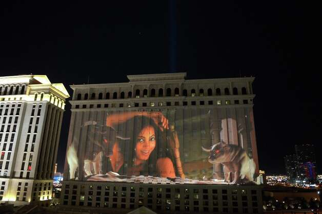 Sports Illustrated projects a 55,000 square foot video of SI Swimsuit Models across Caesars Palace on February 13, 2013 in Las Vegas, Nevada.  (Photo by Michael Loccisano/Getty Images for Sports Illustrated) Photo: Michael Loccisano, (Credit Too Long, See Caption) / 2013 Getty Images