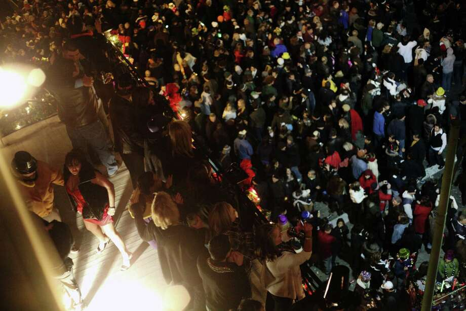 Guests  on the third floor balcony of the Fairmount Hotel enjoy the  fireworks  on New Year's Eve 2009. A reader offers a unique perspective on the building's  historical significance. Photo: File Photo, San Antonio Express-News