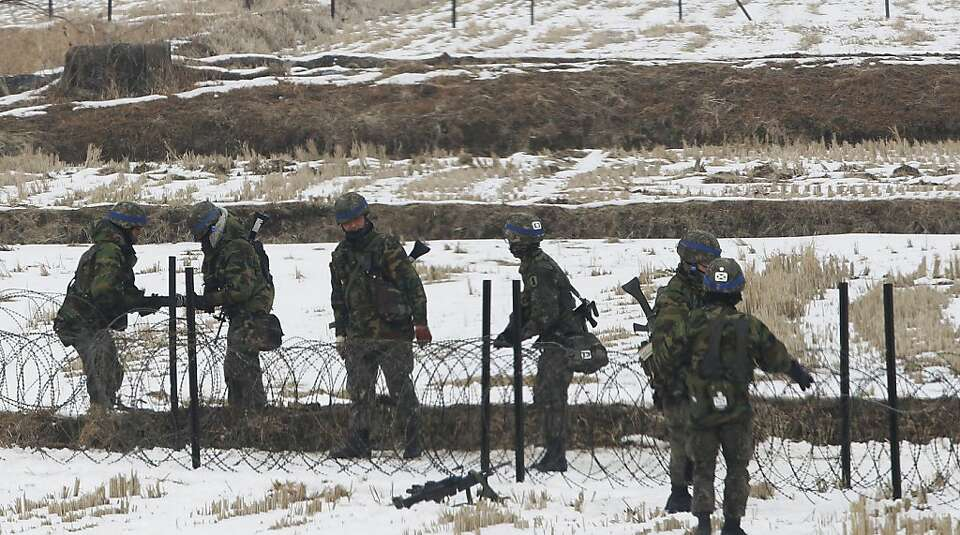 South Korean soldiers set up a barbed wire fence during an exercise near the demilitarized zone.