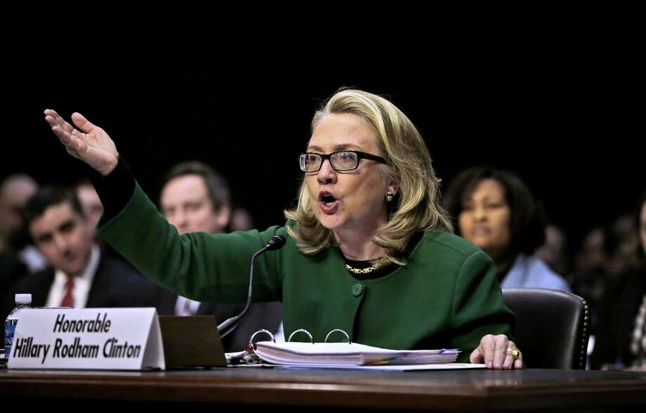 Secretary of State Hillary Rodham Clinton testifies on Capitol Hill on the deadly September attack on the U.S. diplomatic mission in Benghazi, Libya, that killed Ambassador Chris Stevens and three other Americans. Photo: Pablo Martinez Monsivais, Associated Press