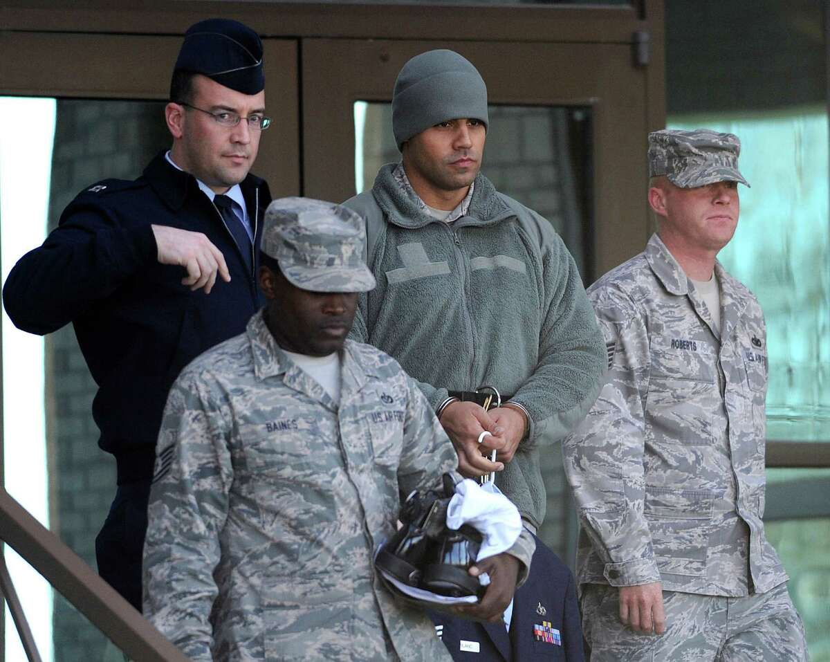 Air Force Staff Sgt. Craig LeBlanc, second from right, is led from a JBSA Lackland courtroom after being sentenced for sex crimes on Thursday, Feb. 14, 2013.