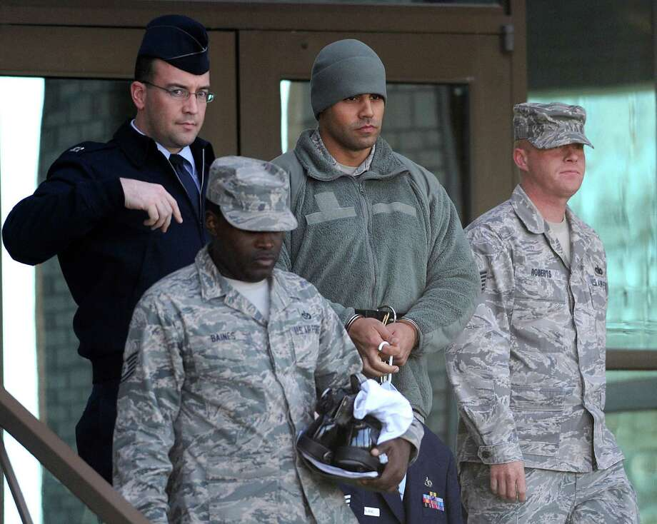 Feb. 14, 2013: Air Force Staff Sgt. Craig LeBlanc, in chains, is led from a JBSA Lackland courtroom after being sentenced to 2 1/2 years after he was found guilty on all but one of nine charges that included a 2011 tryst with a recruit. Facing a battery of allegations that included sexually assaulting a woman, he was at risk of going to prison for 52 years. Read more: Lackland trainer gets prison for sexual misconduct Photo: Billy Calzada, San Antonio Express-News / San Antonio Express-News