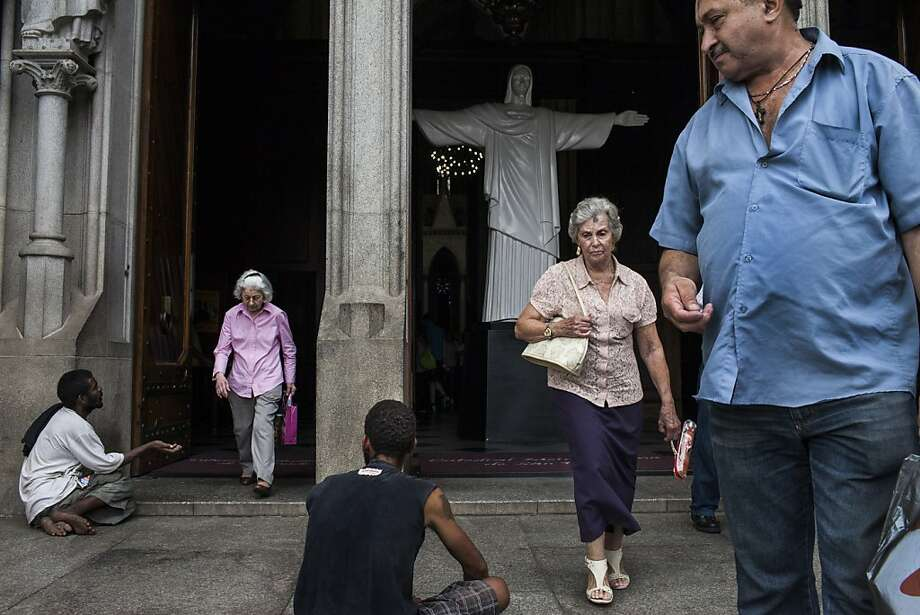 Worshipers leave a Sao Paulo Mass. At one time, 90 percent of Brazilians were Catholic, but no longer. Photo: Mauricio Lima, New York Times