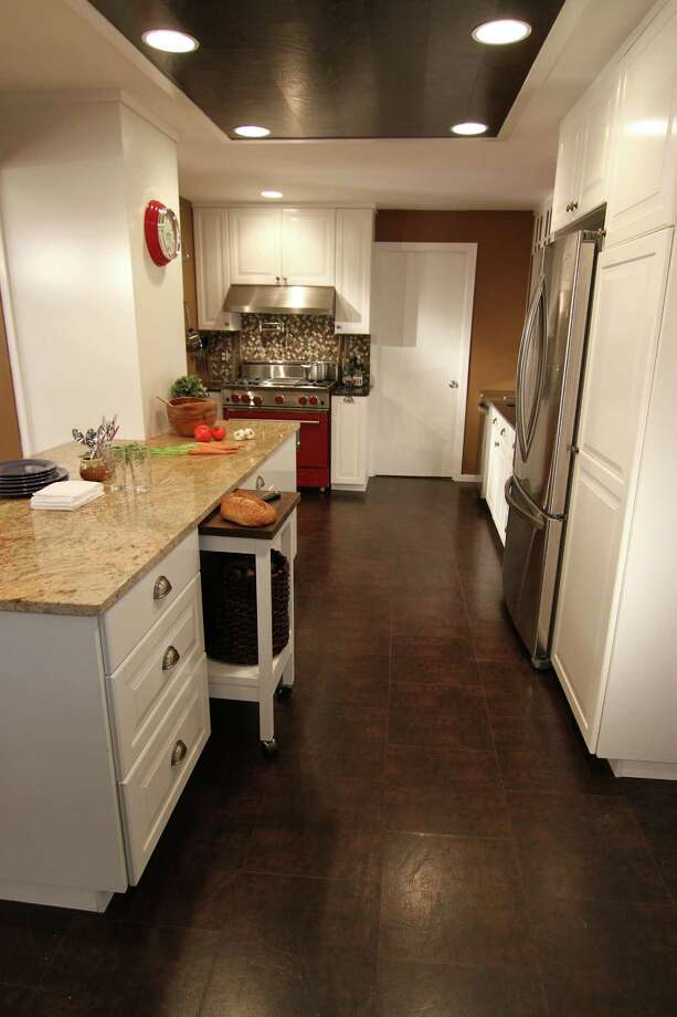 Mahogany-colored bonded leather from EcoDomo covers a kitchen floor. (EcoDomo/MCT) Photo: HANDOUT, HO / MCT