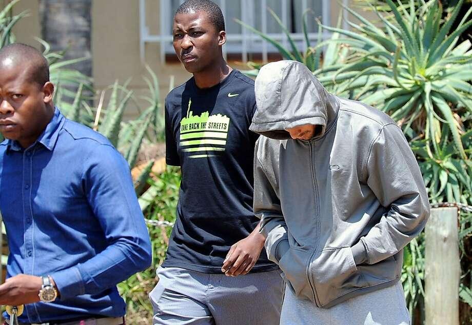 Oscar Pistorius (right) was arrested after his girlfriend was shot dead in his Pretoria home. Photo: Chris Collingridge, Associated Press