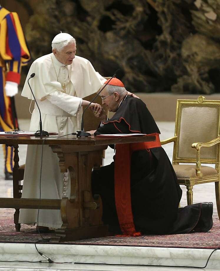 Cardinal Agostino Vallini kneels to greet Pope Benedict as he arrives for his last audience with members of the Roman clergy at the Vatican. Photo: Alessandra Tarantino, Associated Press