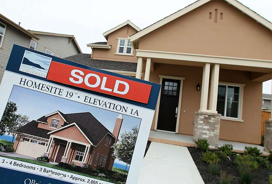 A sold sign is posted in front of a new home in a housing development April 23, 2010 in Pacifica, California. Sales of new homes surged nearly 27 percent in March, the largest single-month increase in 47 years. Photo: Justin Sullivan, Getty Images