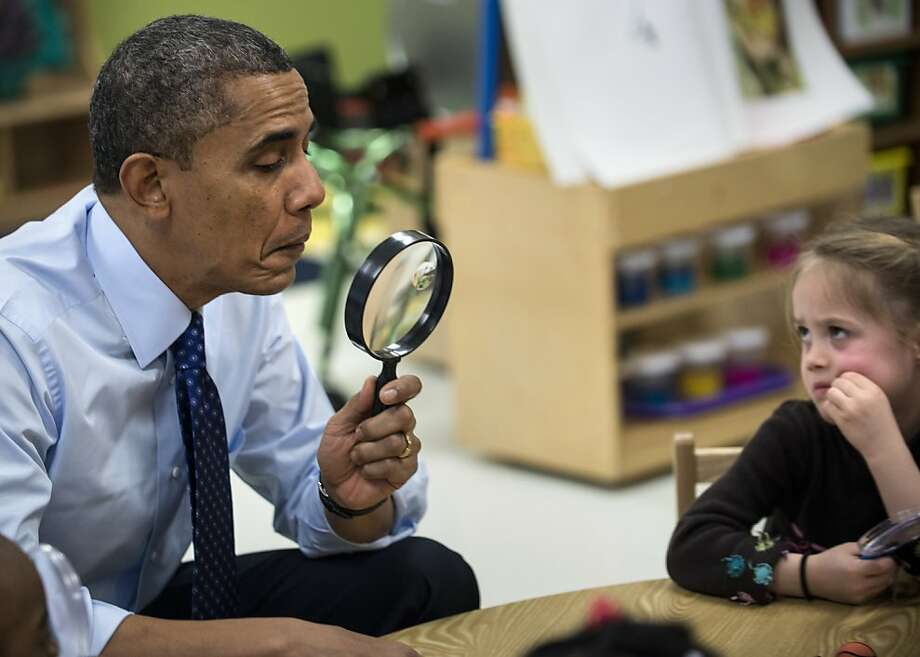Elementary, my dear:President Obama tries to solve the case of the perplexed preschooler at College Heights Early Childhood Learning Center in Decatur, Ga. Obama was in Georgia to promote economic and educational initiatives he spoke about in this week's State of the Union address. Photo: Brendan Smialowski, AFP/Getty Images