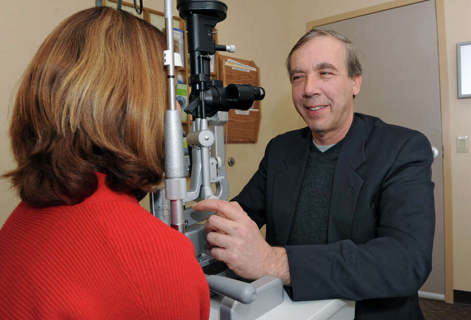 Dr. Jeffrey Stern, a retinal ophthalmologist, examines a patient in his office on Monday Feb. 11, 2013 in Albany, N.Y. Stern won an award from the National Eye Institute for his submission, Endogenous Retinal Repair: Releasing our Inner Salamander. (Lori Van Buren / Times Union) Photo: Lori Van Buren