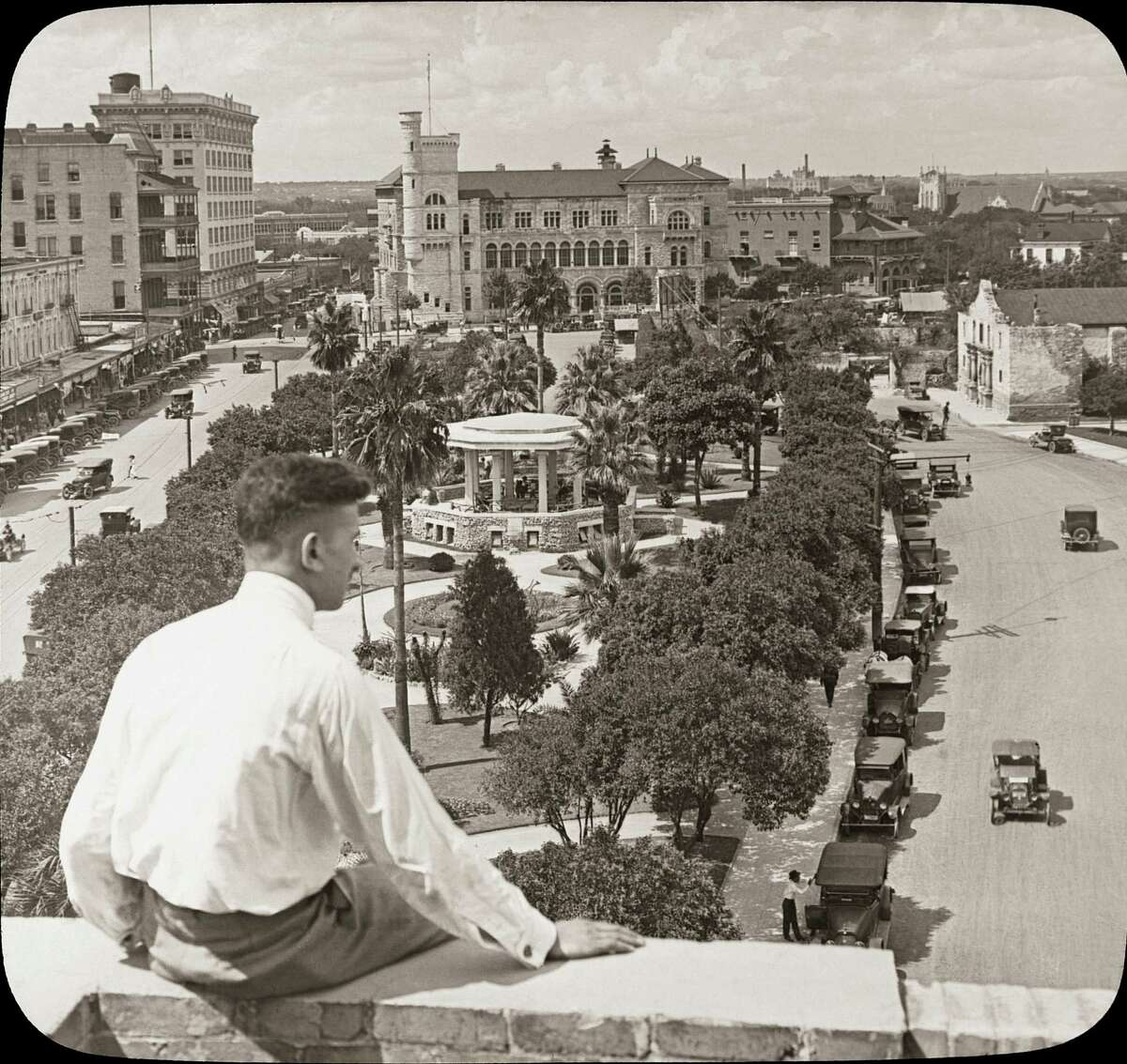 The '20s: The view looking north at Alamo Plaza. The Alamo can be seen at the top right corner.