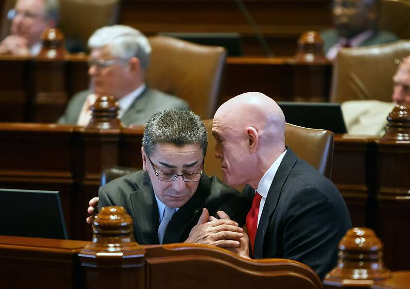 Illinois Rep. Greg Harris, D-Chicago, right, talks with Illinois Sen. William Delgado, D-Chicago, le