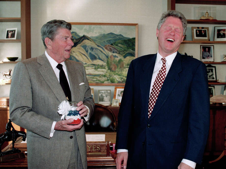 President Bill Clinton, right, laughs as President Ronald Reagan presents him with a jar of jelly beans in 1992. Reagan's love of jelly beans was well known. Clinton preferred junk food, but today is a vegan. Photo: J. SCOTT APPLEWHITE, STF / AP