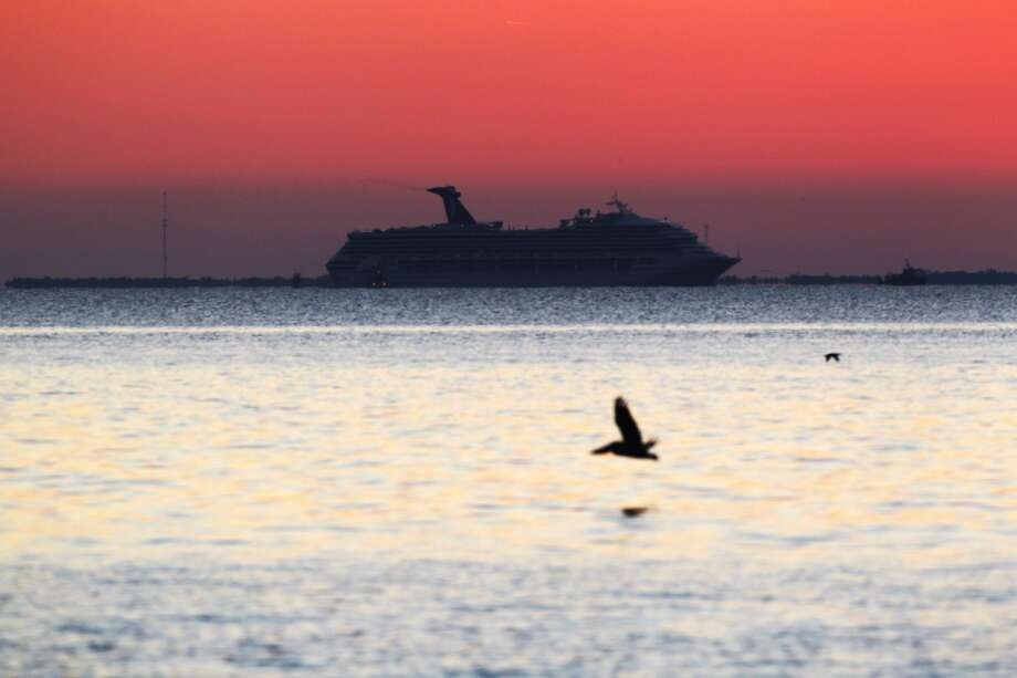 This serene image of the Carnival ship, from Mullet Point Park in Alabama, belies the horror onboard.
