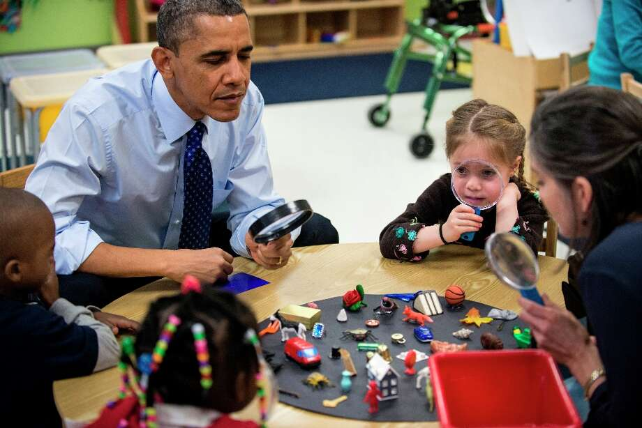 US President Barack Obama plays a learning game while visiting children at College Heights Early Childhood Learning Center February 14, 2012 in Decatur, Ga. Photo: BRENDAN SMIALOWSKI, AFP/Getty Images / 2012 Brendan Smialowski