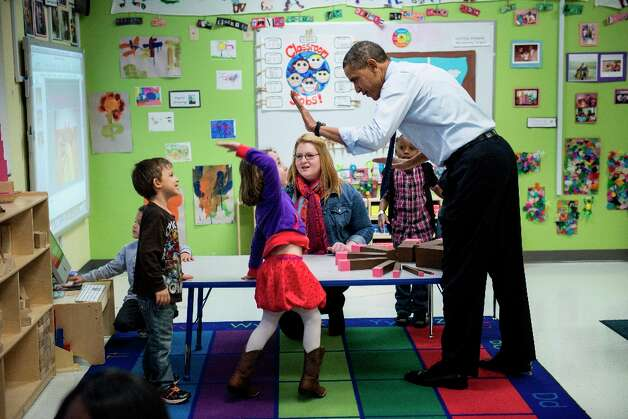 President Barack Obama visits children at College Heights Early Childhood Learning Center February 14, 2012 in Decatur, Ga. Photo: BRENDAN SMIALOWSKI, AFP/Getty Images / 2012 Brendan Smialowski