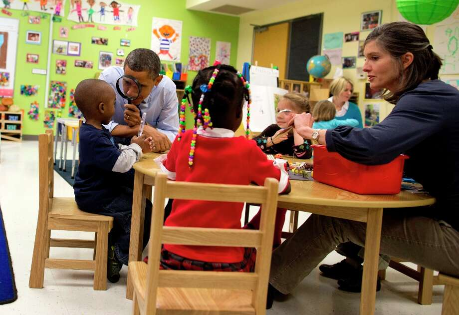 President Barack Obama looks through a magnifying glass during a learning game at a pre-kindergarten classroom at College Heights Early Childhood Learning Center in Decatur, Ga., Thursday, Feb. 14, 2013. Photo: Evan Vucci, Associated Press / AP