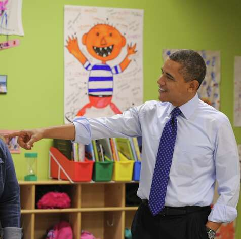 President Barack Obama smiles and greets children at College Heights Early Childhood Learning Center in Decatur, Ga. on Thursday, Feb. 14, 2013. Photo: Johnny Crawford, Associated Press / Pool AJC