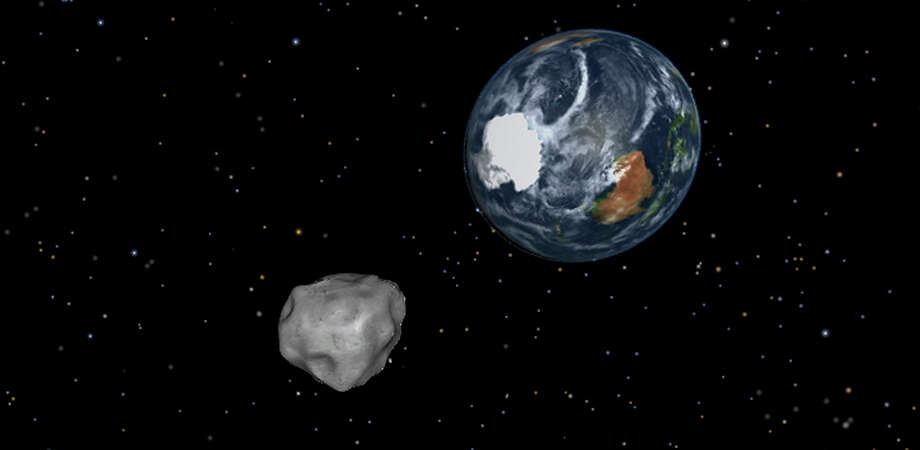 This image provided by NASA/JPL-Caltech shows a simulation of asteroid 2012 DA14 approaching from the south as it passes through the Earth-moon system on Feb. 15, 2013. The 150-foot object will pass within 17,000 miles of the Earth. NASA scientists insist there is absolutely no chance of a collision as it passes. (AP Photo/NASA/JPL-Caltech) Photo: Uncredited, AP / AP2013