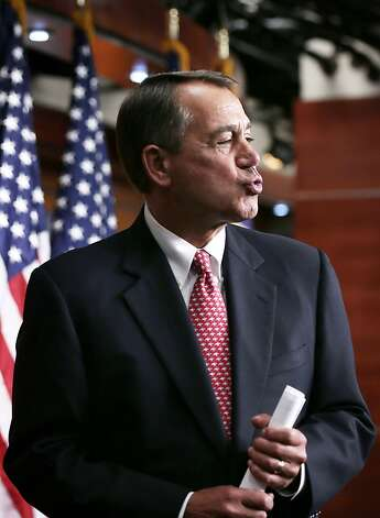 U.S. Speaker of the House Rep. John Boehner (R-OH) puckers up when he is asked by a reporter what he had given to his wife for Valentine's Day at the end of a news briefing February 14, 2013 on Capitol Hill in Washington, DC. Boehner held an on-camera briefing to answer questions from the media. Photo: Alex Wong, Getty Images