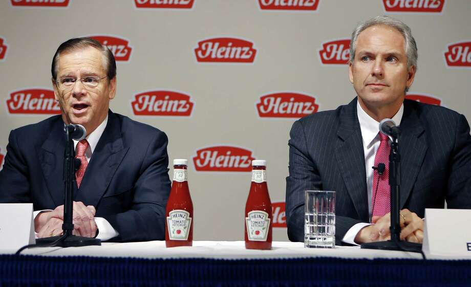 H.J. Heinz Co. CEO William Johnson (left) and 3G Capital managing partner Alex Behring talk about the $23.3 billion deal involving Warren Buffett. Photo: Keith Srakocic / Associated Press