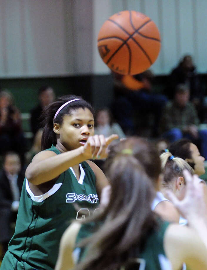 Shelby Holland of Convent passes during the girls high school basketball game between Masters and Convent of the Sacred Heart at the Convent in Greenwich, Thursday, Feb. 14, 2013. Photo: Bob Luckey / Greenwich Time