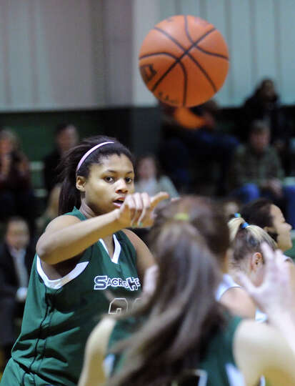 Shelby Holland of Convent passes during the girls high school basketball game between Masters and Co
