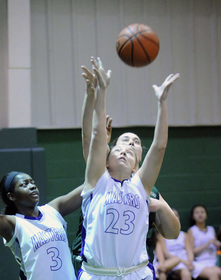 Foreground, Gianna Masini # 23 of Masters goes for a rebound with Emily O'Sullivan # 33 of Convent during the girls high school basketball game between Masters and Convent of the Sacred Heart at the Convent in Greenwich, Thursday, Feb. 14, 2013. At left is Chelsea Strong # 3 of Masters. Photo: Bob Luckey / Greenwich Time