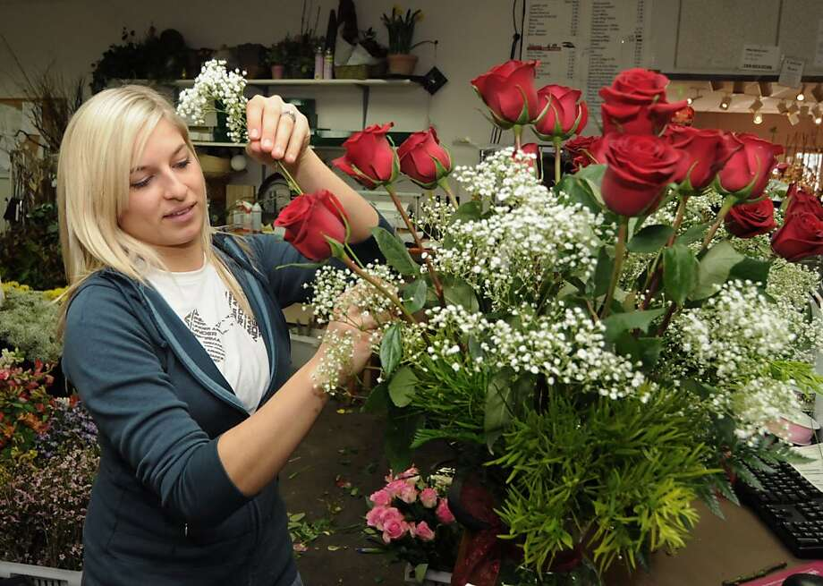 Anna Froehlich arranges a bouquet at Tara Florist Twelve Oaks in St. Joseph, Mich. Florists' sales have fallen with the advent of the Internet and discounted flowers at supermarkets. Photo: Don Campbell, Associated Press