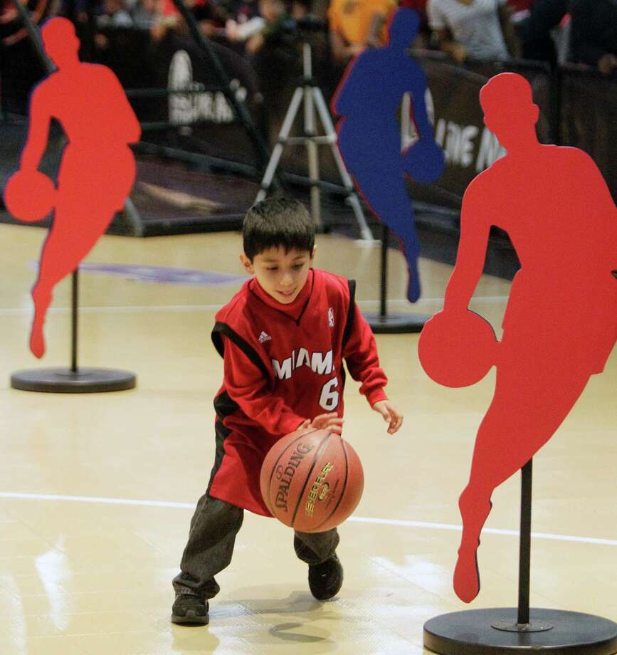 Nicolas Hernandez, 7, of Houston, competes on the Taco Bell Skill Challenge Court at the NBA All-Star Jam Session. Photo: Melissa Phillip, Houston Chronicle / © 2013 Houston Chronicle